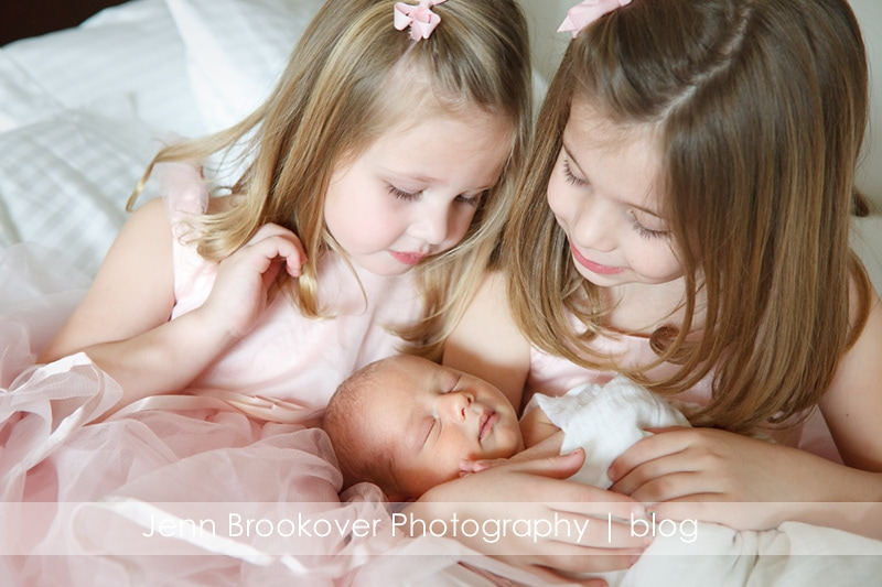 big sisters with newborn