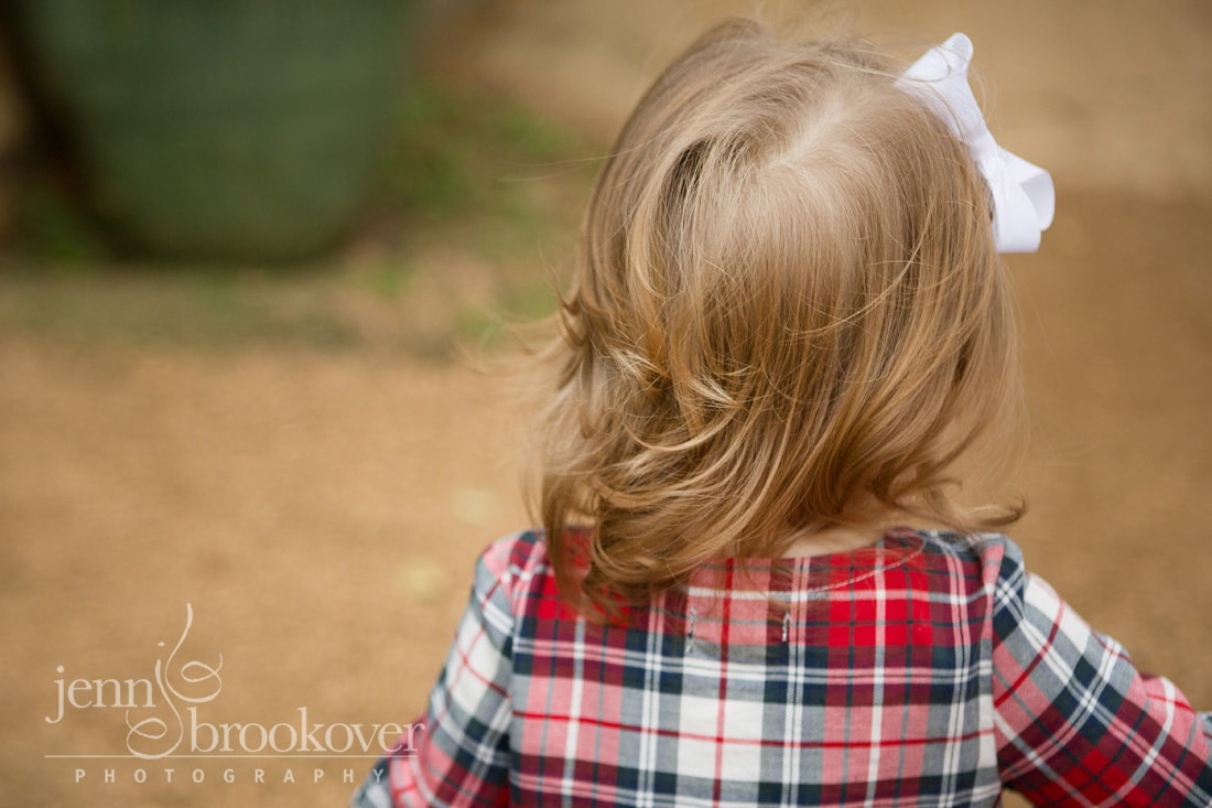 back of little girl's head taken at Tejas Rodeo during photo session