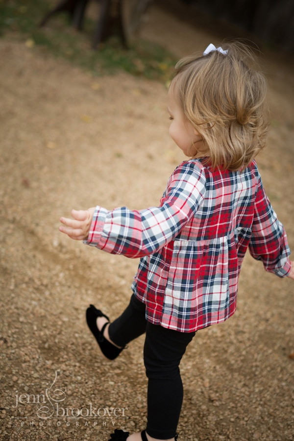 little girl running at Tejas Rodeo during photo session