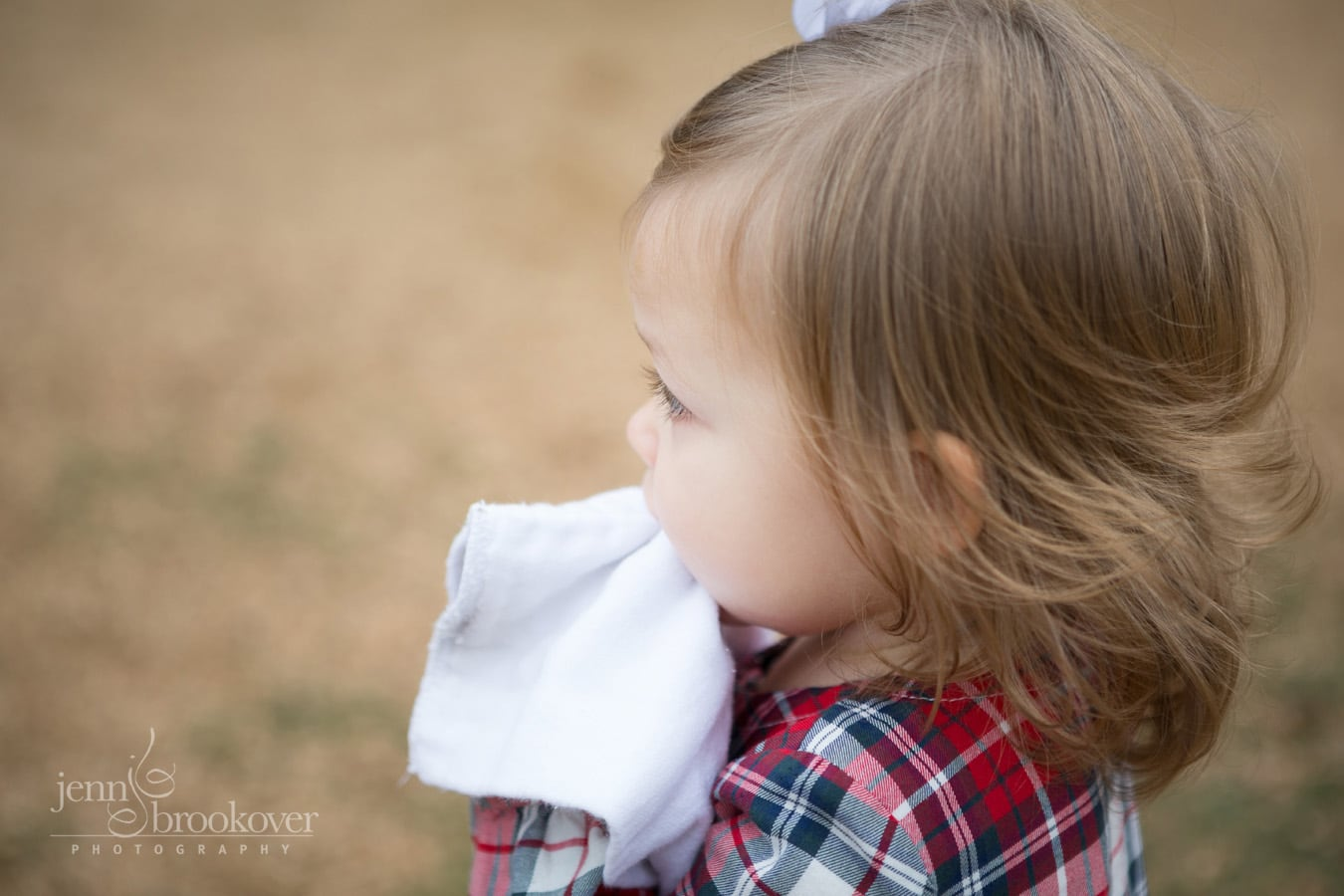 two year old with little curls taken during photo session at Tejas Rodeo