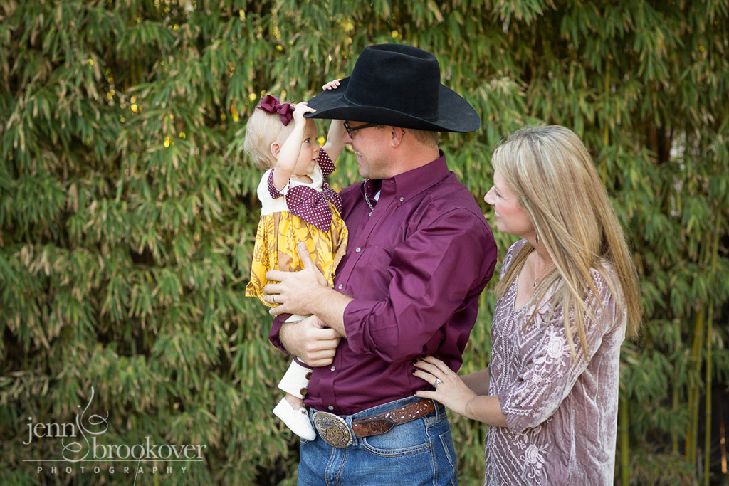 family laughing at Landa Library during their family portrait session, cowboy hat