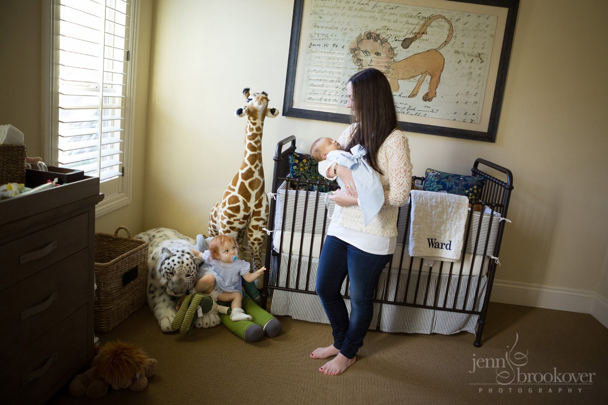 newborn family at home in nursery with toddler and newborn