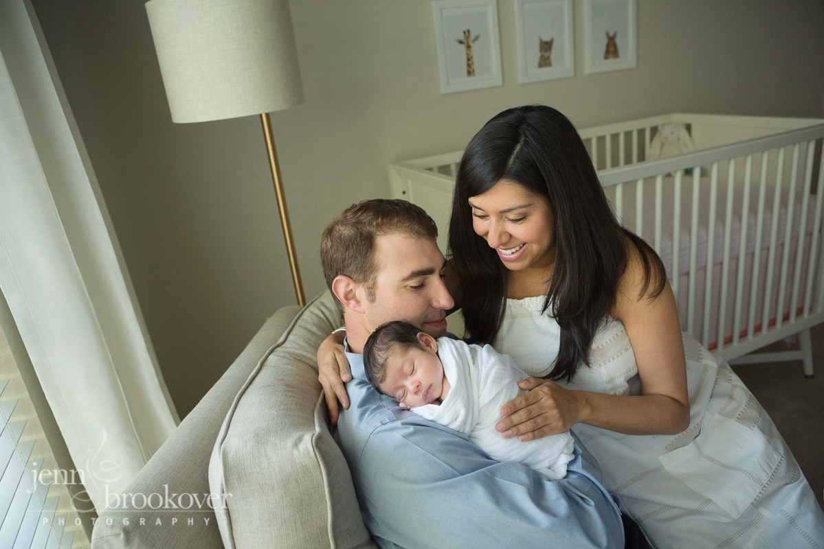 family portrait in nursery taken during lifestyle photo session at home in San Antonio