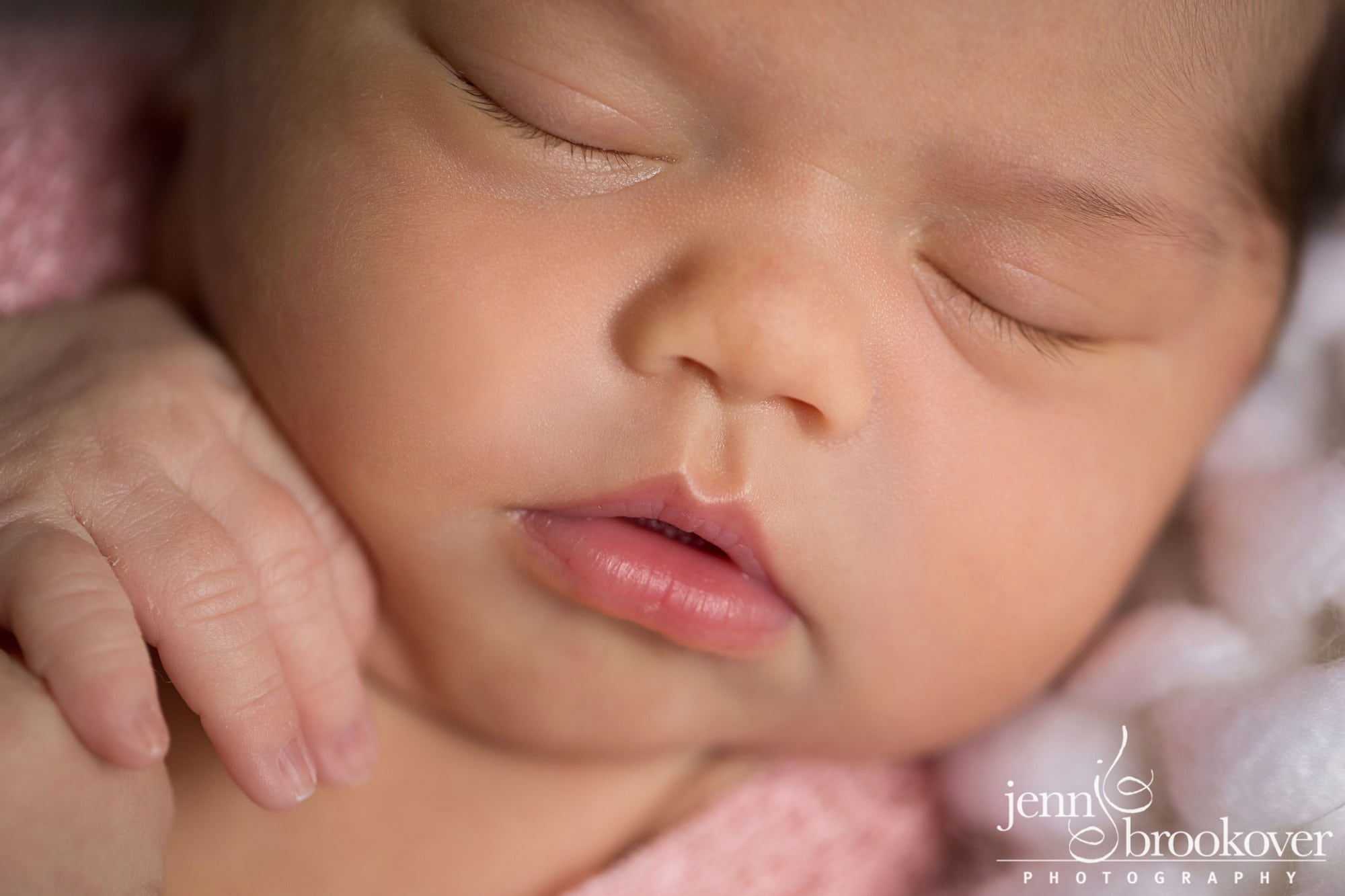 newborn portrait close up on hands, macro taken by Jenn Brookover in San Antonio Texas