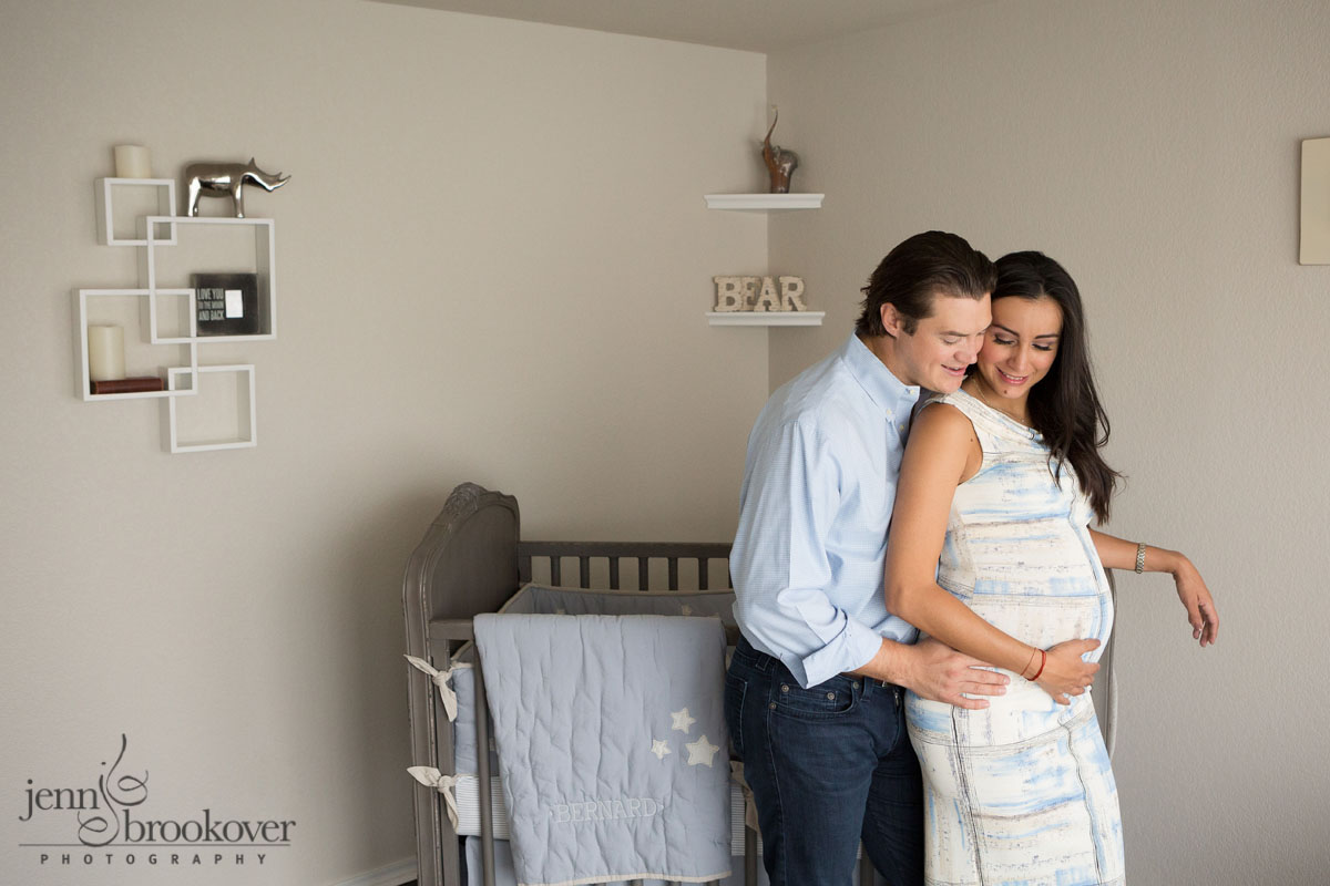 couple in nursery during maternity session at home