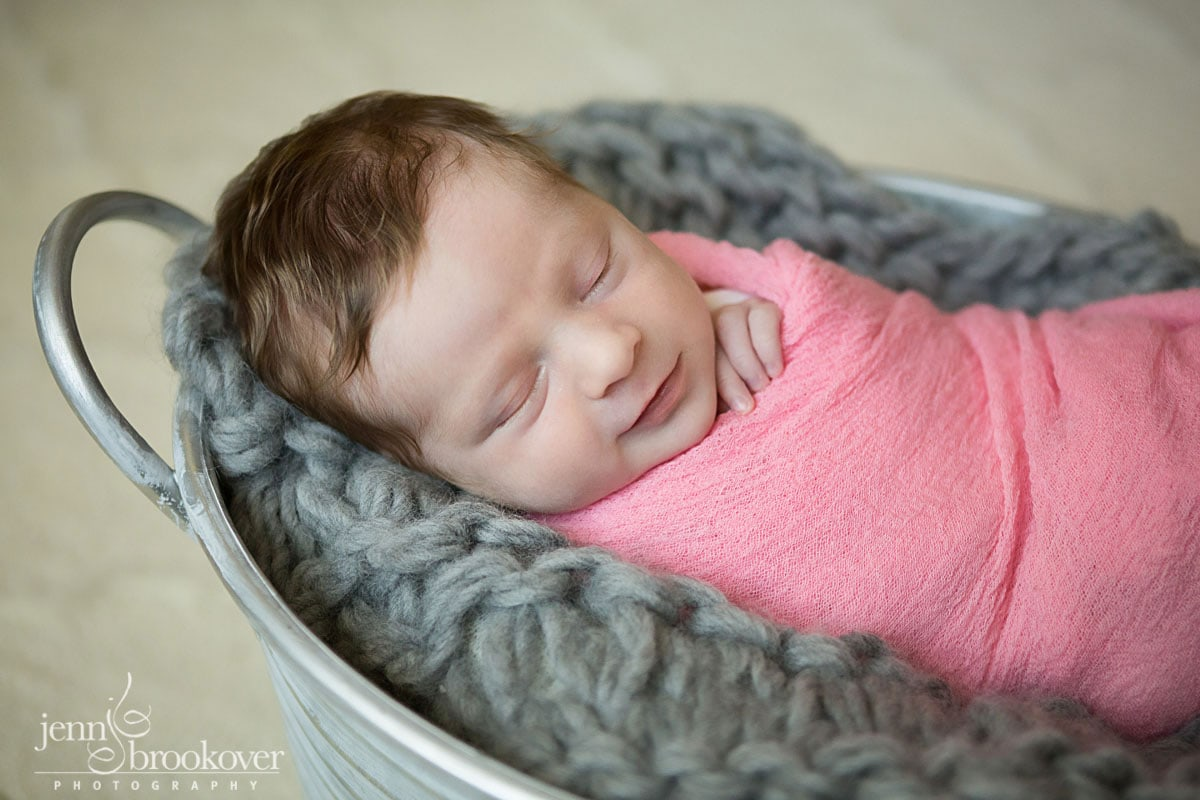 newborn photography at home in San Antonio, Texas, baby smiling