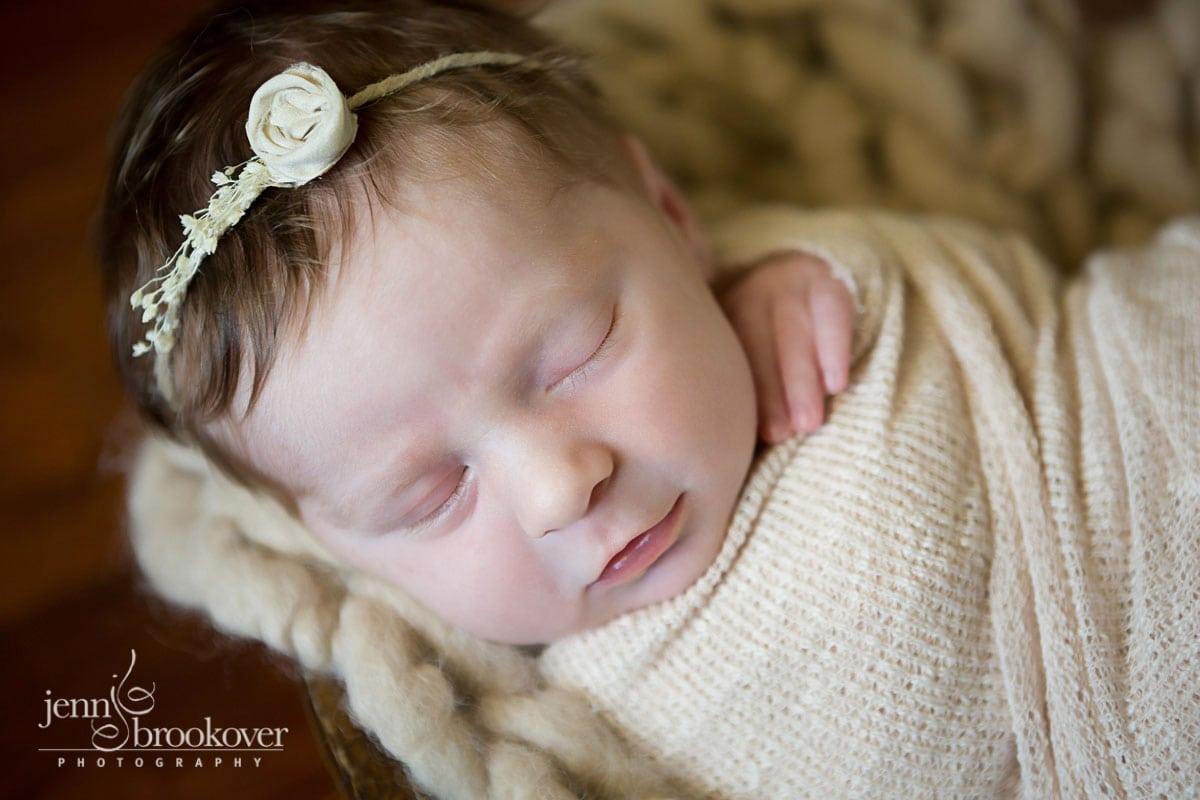 newborn photography at home in San Antonio, Texas, newborn in headband