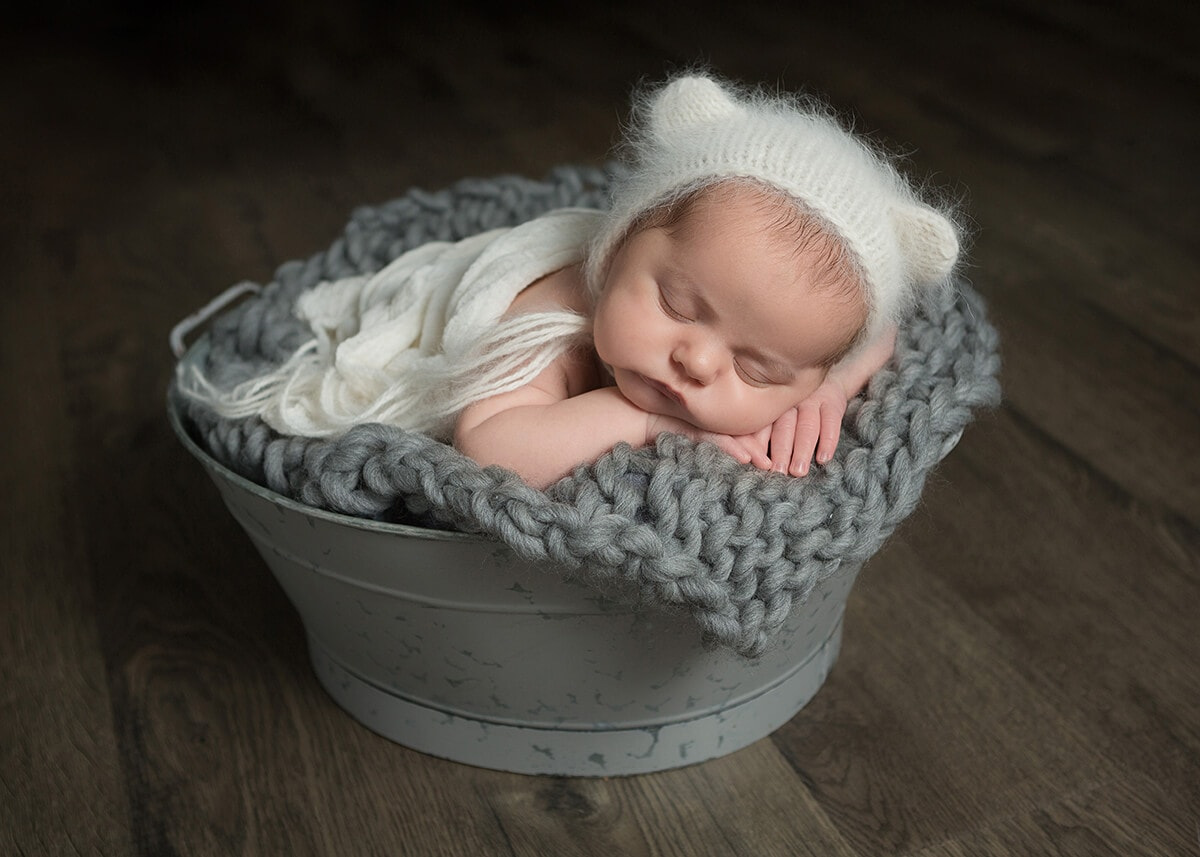 white bear fur bonnet newborn gray tub captured by Jenn Brookover Newborn Photographer San Antonio