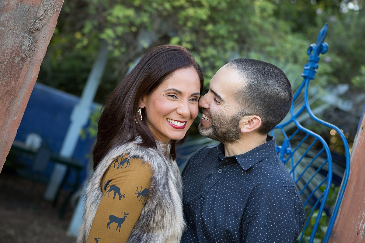 couple laughing and smiling during portrait session at Roszell Gardens in San Antonio, Texas
