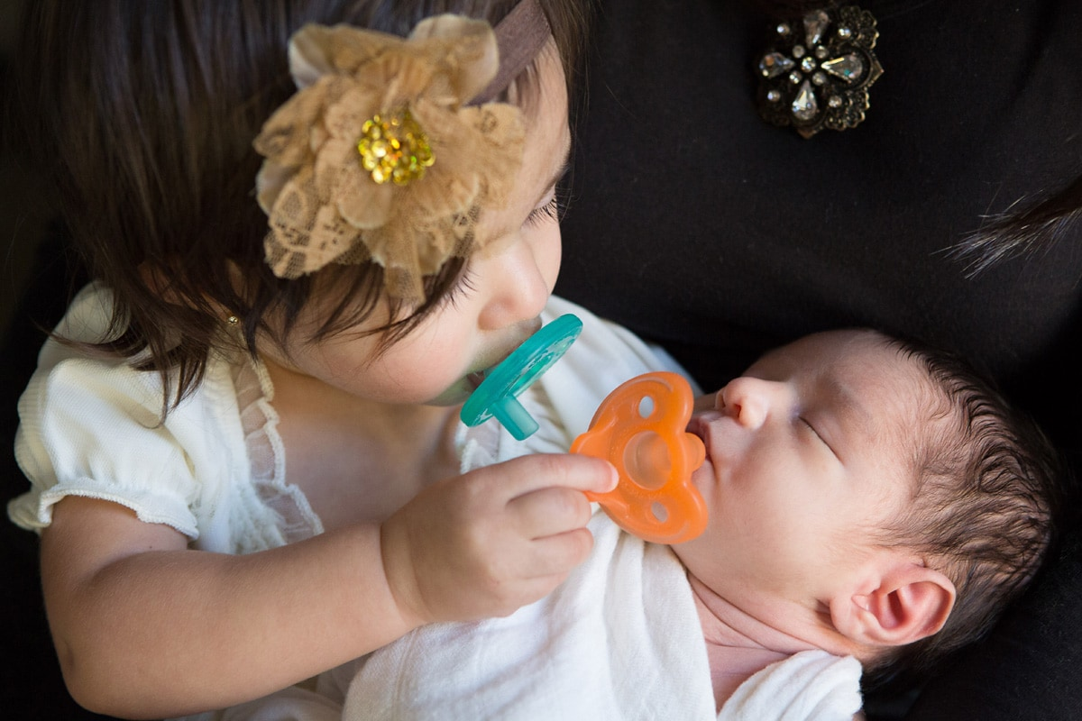 toddler and newborn captured by Jenn Brookover Newborn Photographer San Antonio