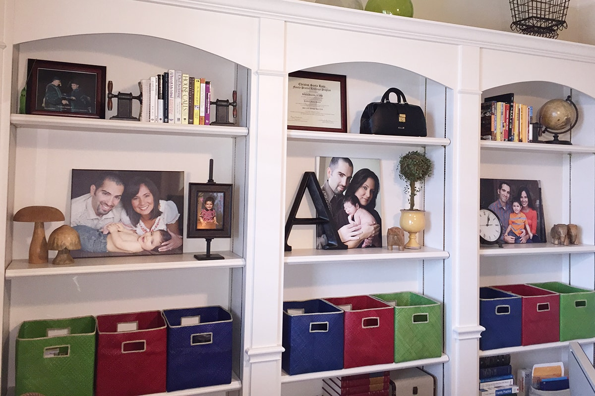 collages on shelves in an office at home
