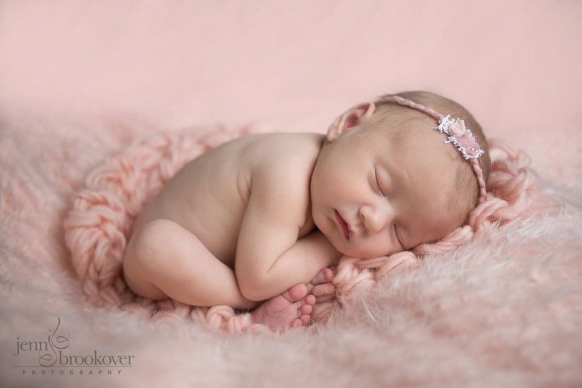 San Antonio newborn portrait of baby on pink blanket showing her little feet taken by Jenn Brookover