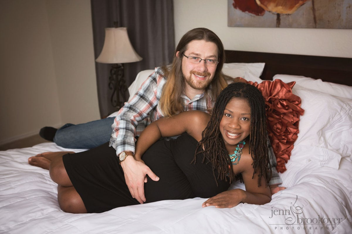 maternity portrait of mom and dad smiling at home in San Antonio Texas by Jenn Brookover
