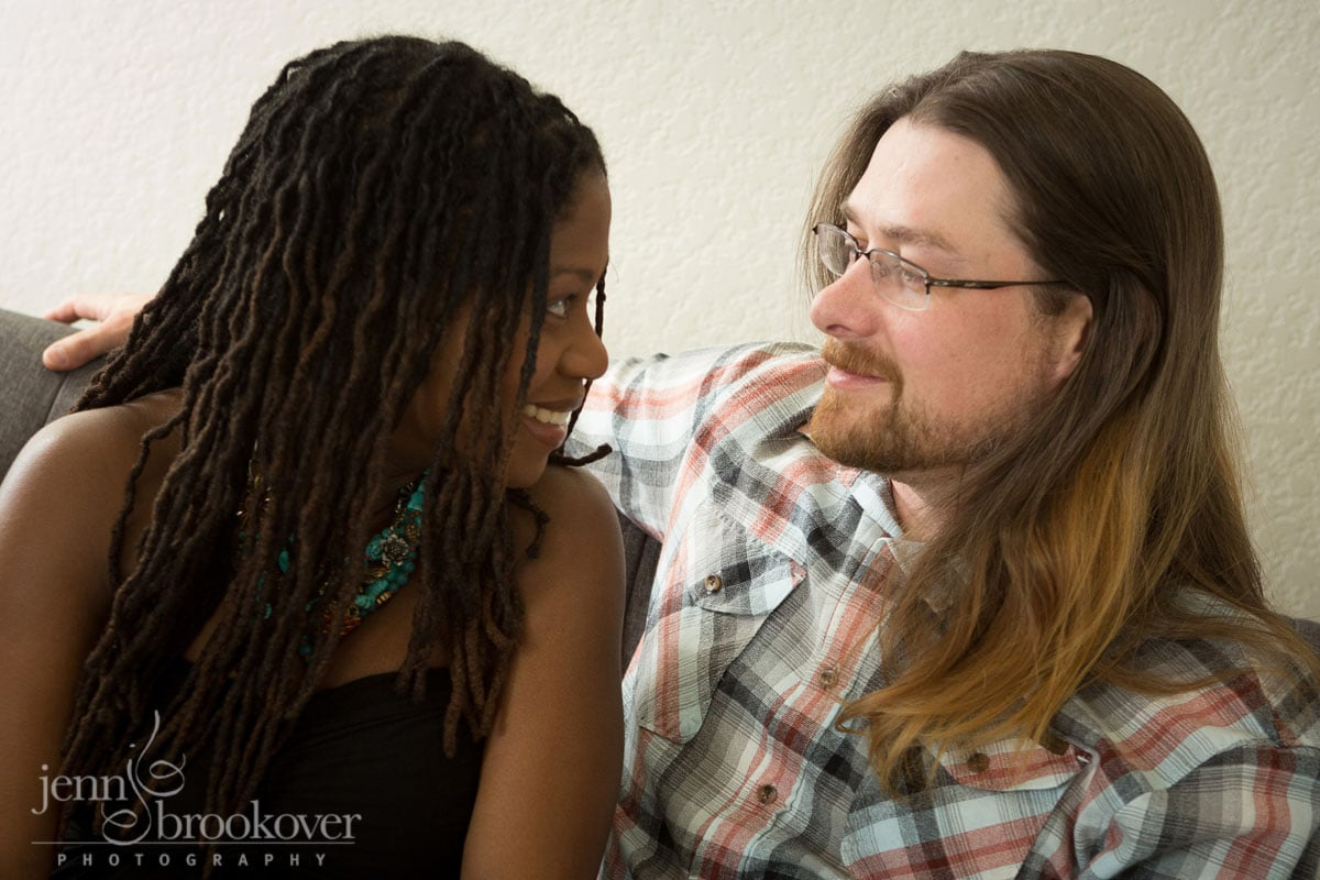 happy couple looking at each other in a portrait taken during their maternity session by Jenn Brookover Photography