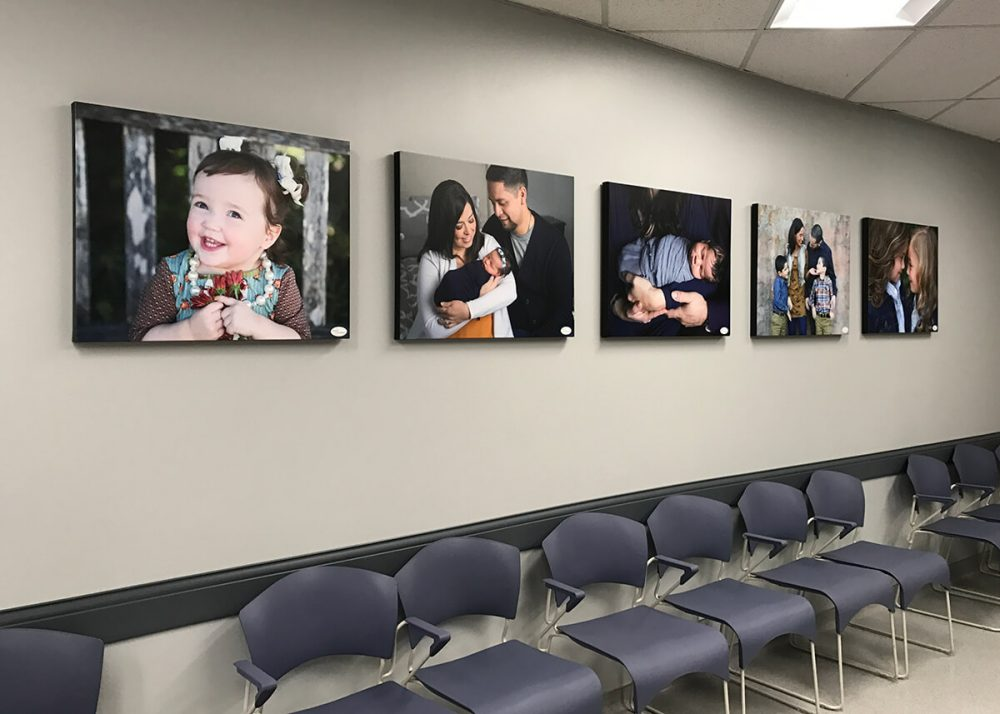 canvas wall at Southwest Children's Center of family portraits