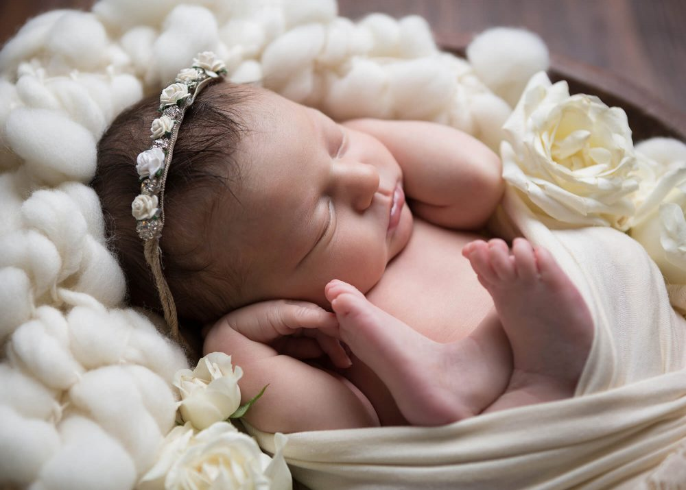 newborn baby girl in cream headband and roses Alamo Heights Texas