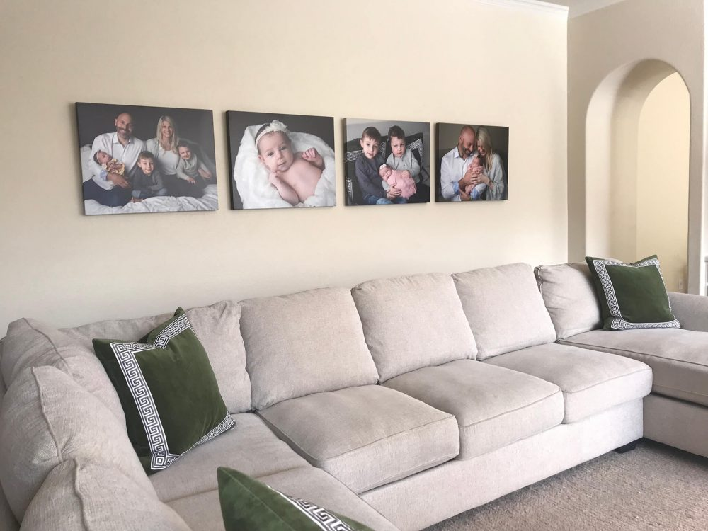 canvas wall of family and newborn pictures