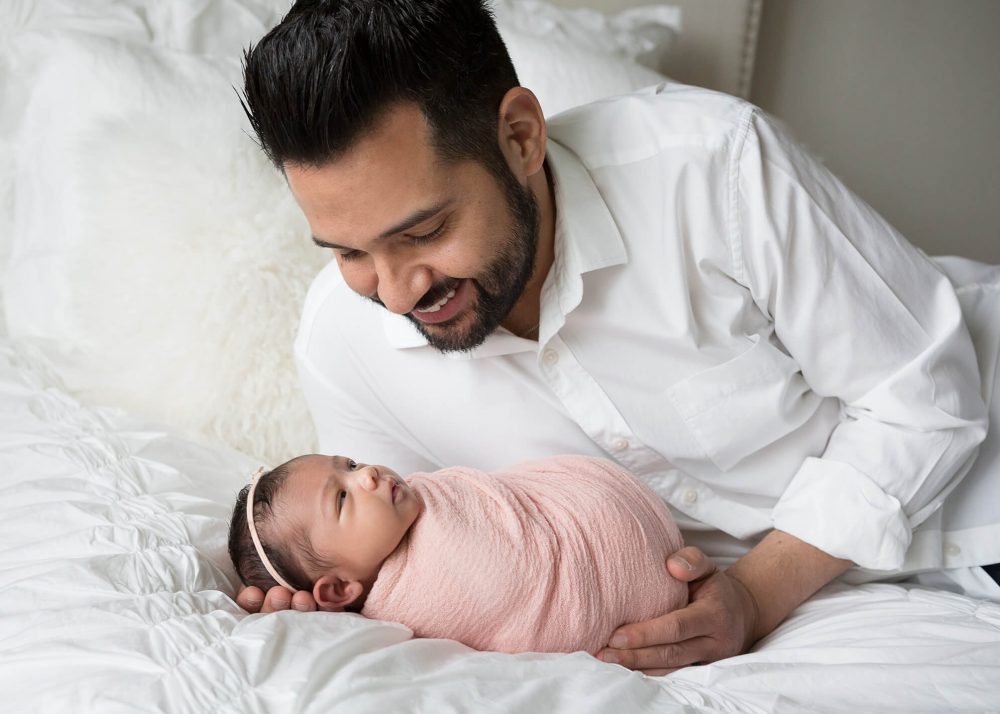dad and daughter pink smiling during newborn photo session