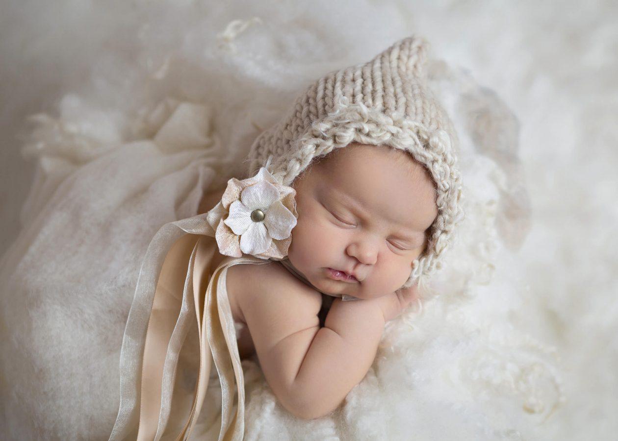 newborn in peach and cream flower