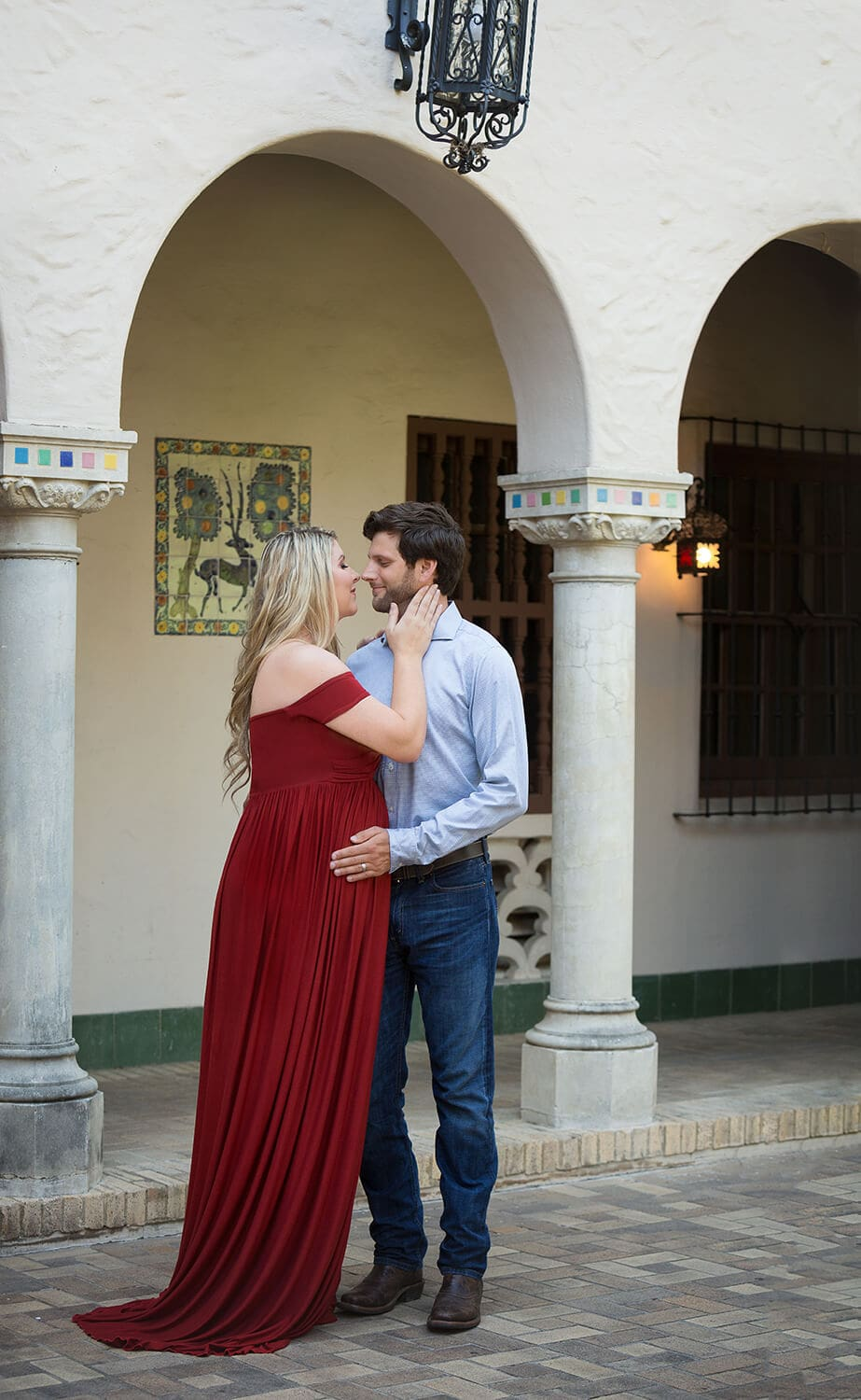 maternity portrait at the mcnay in San Antonio Sew Trendy red dress