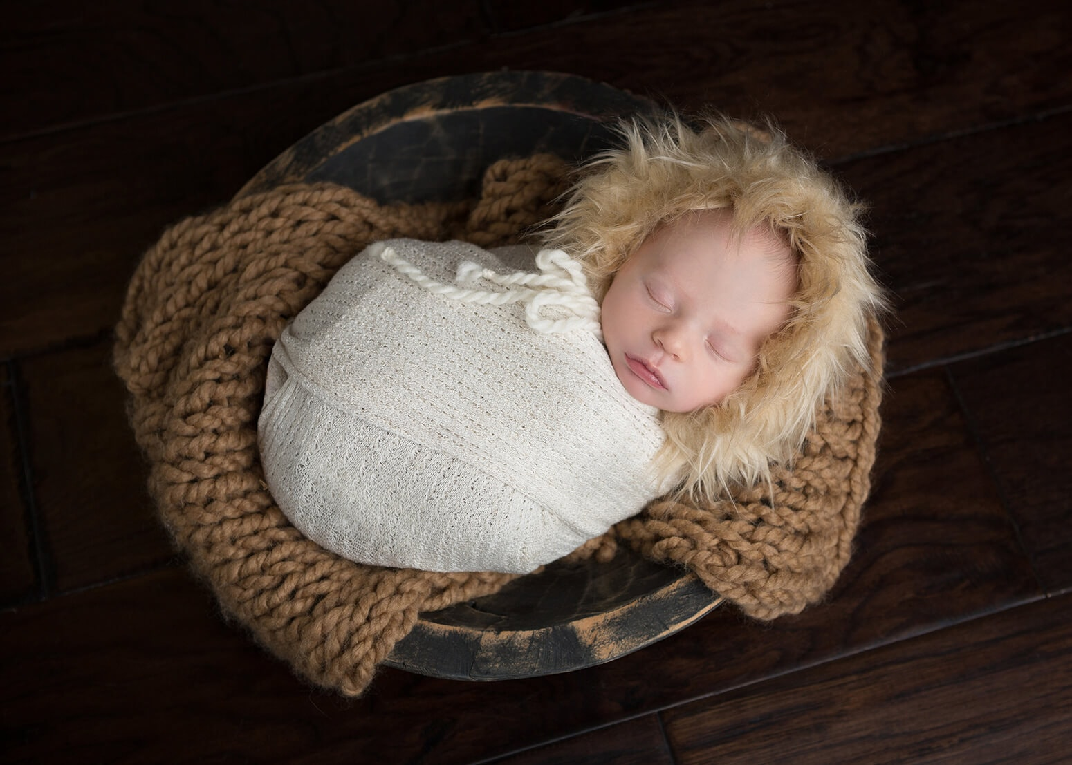 newborn photography San Antonio boy in a fur hat