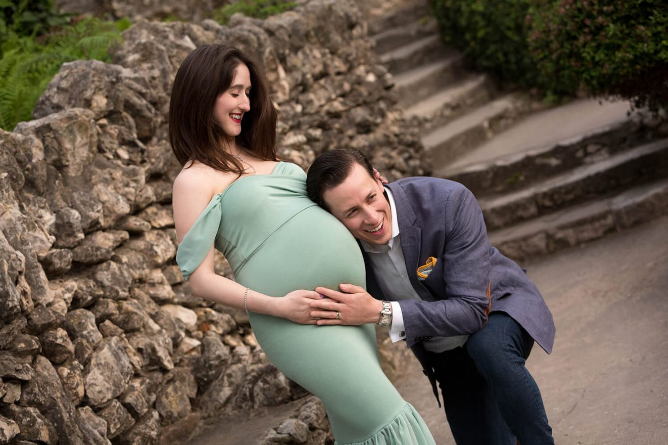 couple at Japanese tea garden in San Antonio, Texas mom in sage green dress for maternity photo session