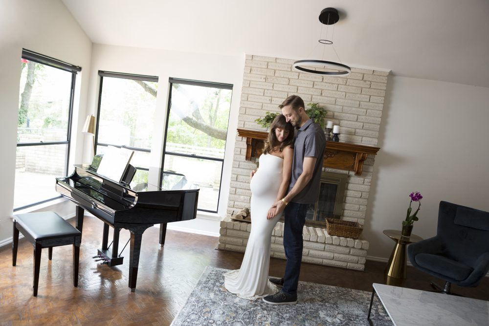 lifestyle maternity session at home couple near piano